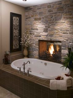 Furniture, Excellent Small Bathroom With White Oval Tub And Wall Stone With Gas Fireplace Also Wall Painting Decoration: Decorate Your Living Room With Rustic Fireplace Stone Ideas