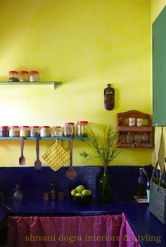 Love the use of colour in stylist Shivani Dogra's Delhi apartment. The little wooden mask on the kitchen wall really stands out.