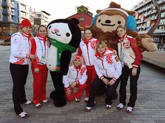 Members of the Russian Winter Olympic team pose for a photo with mascots Miga and Quatchi during a media tour of the Olympic Village in downtown Vancouver on February 9, 2010. (Photo by Mark Ralston/AFP/Getty Images)