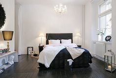 love the black bed in the all white room.