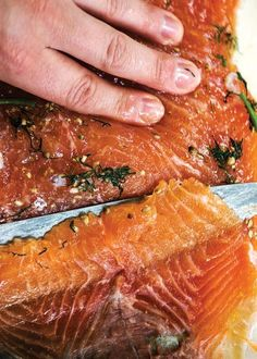 A salt and sugar cure flavored with fresh dill transforms salmon into gravadlax, silky ribbons of fish ready to be piled atop slices of rustic brown bread or crunchy rye crispbread for a Swedish Midsummer feast.