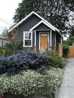 Black Tiny House, White Trim. I love the Scandinavian style color scheme.