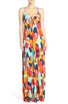 Gorgeous rainbow-colored diagonals cover the flattering flared cut of this full-length slipdress. Too cute!