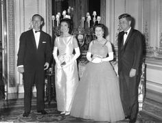 Britain's Queen Elizabeth II poses with U.S. President John F. Kennedy, before a state dinner at Buckingham Palace, June 5, 1961. Also seen are the Duke of Edinburgh, left, and President Kennedy's wife Jackie, second left.