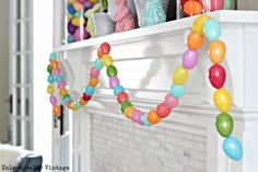 Fun spring mantel with the cutest DIY egg garland! eclecticallyvitnage.com