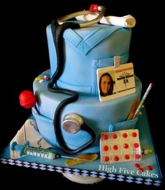 Nursing Grad - 2 tiered graduation cake for RN.  All edible materials.  Accents are sculpted using gumpaste and fondant.