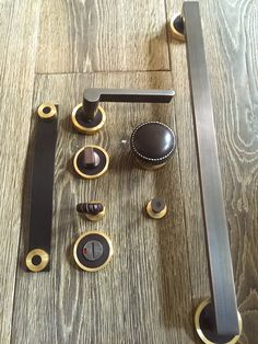 House of Eroju collection of Lever handles, Door knobs, Pulls and Escutcheons in leather, bronze and brass finishes.