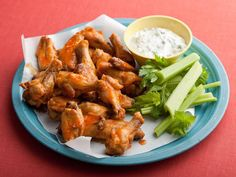 Alton's Buffalo Wings: Alton's chicken wings are quickly steamed then roasted and tossed in a classic buffalo-style sauce.