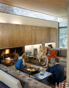 I like the narrow plank ceiling and the panels above the fireplace.