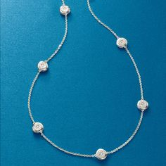 Large bezels paved with 1.00 ct. t.w. diamonds give this classic necklace a lovely radiance. Sterling silver necklace. >>See this 1.00 ct. t.w. Diamond Station Necklace in Sterling Silver. #diamond #necklace #layer #stationnecklace #accent #classic #timeless #silver