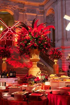 Themes - McCalls. Flowers and feathers in the food station arrangements for a Moulin Rouge themed corporate event at City Hall.