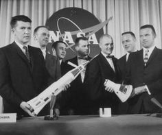 The Mercury astronauts pose after the press conference on April 9, 1959