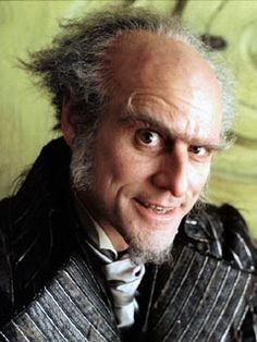 """Count Olaf from """"A Series of Unfortunate Events"""" - here is a villain who began rather creepily (in the first two books), then became hilarious, and ended rather sympathetic. Olaf has got to be one of my absolute favorite villains. :)"""
