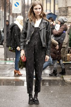 all black with peek of white thermal: matted down waves, black overalls with tapered leg, black leather jacket and loafers, black socks and light grey smokey eye