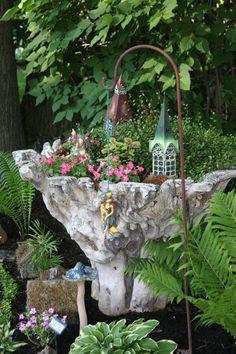Favorite fairy garden container, originally sold as a table base, but makes a way cool garden