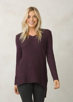Breeze through fall in this long soft knit tunic. Mid weight sweater with a  dropped hem tail and side vents for a relaxed 4d35a92c0