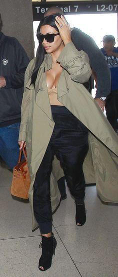 The Selfish author made her way through LAX wearing comfortable Haider Ackermann joggers and a nude bodysuit covered with an olive trench coat.