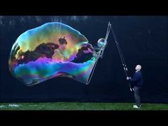 This video features a few of my large free-floating bubbles. For more information about the bubble juice and wick materials used, please visit waynesthisandt. Bubble Juice, Bubble Mix, Bubble Recipe, Giant Bubbles, Craft Activities For Kids, Kids Crafts, Soap Bubbles, Craft Night, Child Life