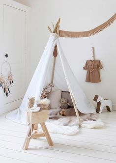 "Micro Trend: Teepees "" Have you noticed too a certain Native American trend on the rise, both in fashion and interior with loads of arrows, feathers and teepees? What do you think about it? I know in fashion, there have been issues raised about whether or not showing a model wearing a headdress is culturally appropriate. What do you think?...I say let us embrace the latest movement..."" Whyyyyyy????"