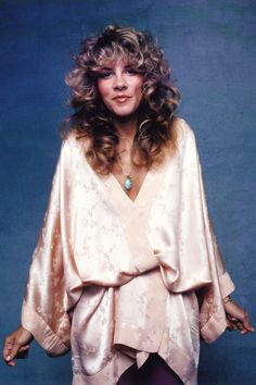 Stevie Nicks curly blonde highlights More