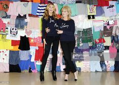 Abbey Clancy and Joanna Lumley attends a photocall to launch the M&S 'Love, Mum' shwopping campaign in conjunction with Oxfam at Marks & Spencer Marble Arch on February 4, 2014 in London, England.