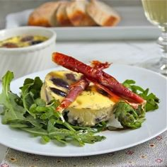 Savoury Fig Custards with Prosciutto Spirals, on a bed of arugula with a balsamic reduction.