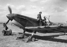 """S/L Rupert HA """"Lucky"""" Leigh climbs into Spitfire Mk I LZ-N at RAF Gravesend in September 1940, while a ground crewman runs up the engine. The aircraft carried a rank pennant beneath the windscreen, a pre-war tradition rarely seen during the time. The 28-year-old CO was credited with 1 and 1 shared destroyed while leading No 66 Squadron RAF between April and October."""