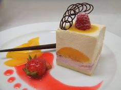 Mini-size Peach/Strawberry Mousse: Plated dessert with 4cm square size mouuse (peach & strawberry mousse with tin layer of vanilla cake) decorated with fresh raspberry & peach sauce on top