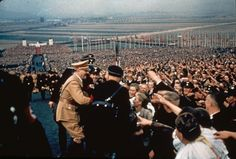 Hugo Jaeger—Time & Life Pictures/Getty Images.  Adolf Hitler greets the cheering throng at a rally in 1937.