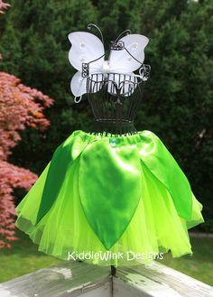 Tinkerbell tutu with satin overlay >not using the tutu  as it's not for a tinkerbell costume > just want this photo for the shape =  med green felt leaves attached under belt over lt green tunic.