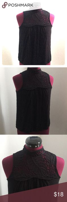 Black Top from H&M Size 2 Black Top from H&M, loose fitting with crochet detailing at top and mock turtleneck neckline. Buttons down the top of the back. 100% Viscose. Worn only once or twice. H&M Tops Blouses
