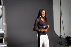 """DJ Kiss rocking her Saints' emblazoned All Sport Couture top backstage at a photoshoot for the """"It's My Team"""" NFL women's clothing campaign!"""