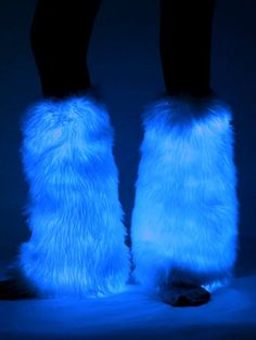 A hot girl raver wearing light up fluffy leg warmers from Electric Styles.