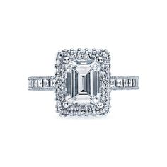 Tacori style no. HT2517EC85X65. An emerald cut diamond is given a dazzling design with a unique double bloom for a look of amazing shine and sparkle. Princess cut diamonds create another level of glitz on this glittering showstopper.