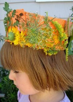 Spring Nature crowns.  Collect greens, flower buds, grass seed, etc. and glue to a length of construction paper stapled in a ring which will fit atop your child's head.
