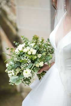 White and green bridal bouquet with mixed greenery and white flowers. White ranunculus gypsophilawhite spray roses ivory roses white veronica succulents olive eucalyptus rosemary and spirea. Lush bouquet with texture. White Rose Bouquet, White Ranunculus, Rose Bridal Bouquet, White Wedding Bouquets, Floral Wedding, White Flowers, Green And White Wedding Flowers, Wedding Greenery, Green Flowers