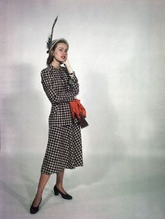New York 1950 Modeling a plaid day dress. Image by Genevieve Naylor/C