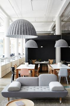 Muuto Under the Bell pendant lights are made from recycled plastic felt, which helps absorb noise and improve acoustics—a key feature in the open office.