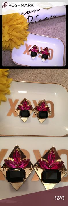 Gold Crystal Statement Earrings Hinged gold plated triangles connect the 2 pieces of these beautiful earrings; vibrant pink crystals fan across the top and a stunning black stone anchors the bottom of these earrings that scream glamour! Be the diva you are with these statement earrings. Pull your hair back and show them off. Diamonds aren't the only best friend for this glamour girl! Boutique by T&J Designs. T&J Designs Jewelry Earrings