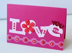 Love You - Scrapbook.com - Made with brand new Queen and Company supplies.