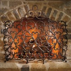 Ideas decorative yet protective wrought iron fireplace screen cast iron scrollwork fireplace screen i think this would look great in front of our teraionfo