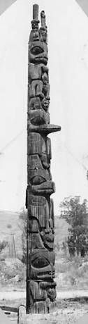 Title Haida Chief Sonihat's totem pole relocated in Los Angeles, California Notes A Kaijani (subtribe of the Haida) totem pole sits alone next to a path in an area of sparse vegetation . Note from Garfield Volume: Pole belonging to Mark's Lumber Mill, Los Angeles.  Note from unidentified source: Chief Sonikat's pole from Kasaan, moved to Los Angeles .  In Garfield Volume 3, leaf 37 Subjects Sonihat, Chief; Haida Indians; Totem poles--Alaska--Kasaan; Totem poles--California--Los Angeles