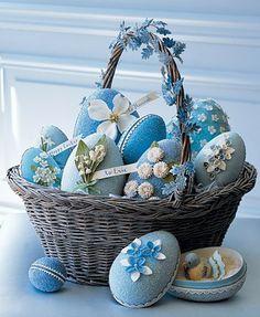 Wicker Easter basket full of blue eggs