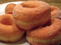 Who can resist a doughnut (donut)? The best recipe for the most perfect yeast doughnuts ever. Dip in sugar or fill with jam, Nutella or cream. Recipes With Yeast, Baked Donut Recipes, Baked Donuts, Baking Recipes, Dessert Recipes, Biscuit Donuts, Yeast Donuts, Doughnuts, Cookies Et Biscuits