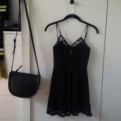 Black lace dress Zipper on back, mid thigh on me (I'm 5'1) Nasty Gal Dresses Mini