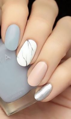 Spice up your typical pastel mani with a marbled accent nail. Keeping it in neut… Spice up your typical pastel mani with a marbled accent nail. Keeping it in neutral shades prevents this look… Spring Nail Art, Nail Designs Spring, Spring Nails, Nail Art Designs, Nails Design, White Nails With Design, Summer Nails, Nail Art Ideas, Round Nail Designs