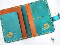 Leather Passport Cover – Turquoise Dreamcatcher – Steer skull and sunflowers – Day of the Dead Southwestern Feathers – Made to Order Leather Passport Cover Turquoise Dreamcatcher Steer skull Leather Passport Wallet, Leather Wallet, Leather Jewelry, Leather Craft, Leather Conditioner, Leather Bags Handmade, Handmade Bags, Leather Pattern, Passport Cover