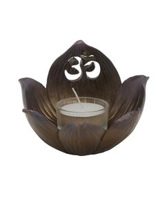 This beautiful bronze finish lotus flower with cutaway Om symbol can be used as a tealight holder and as an incense burner to enhance meditation rituals.