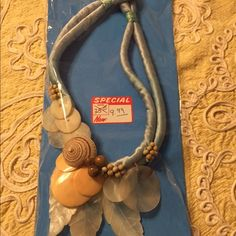 Vintage statement necklace💖 Mix of puka and natural shells ; and puka beads assemble in heavy blue silky cord . Uniquely  hand made in 90's.new w/o tag. Jewelry Necklaces