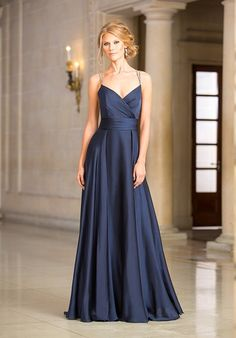 Flowing Amber Satin Chiffon A-line gown with a v-neckline, and beaded straps that crisscross in the back.  Also available in tea or knee length.